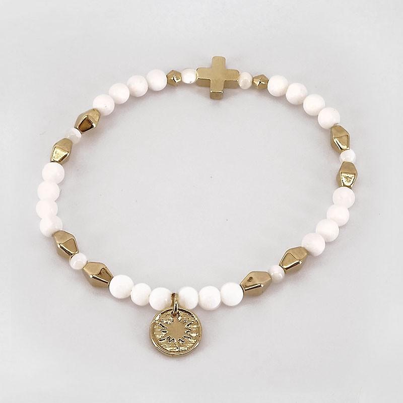 Bracelet élastique avec croix, Pampilles en métal doré à l'or fin 24cts. CHORANGE Créateur Bijoux Fantaisie à Cannes.